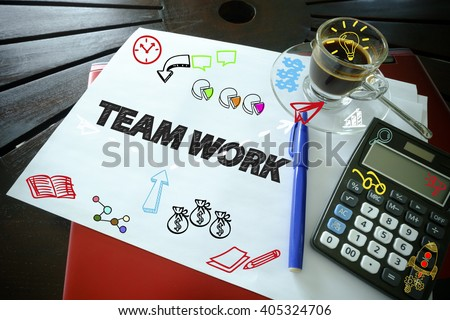 drawing icon cartoon with TEAM WORK   concept on paper in the office , business concept , business idea , analysis concept - stock photo