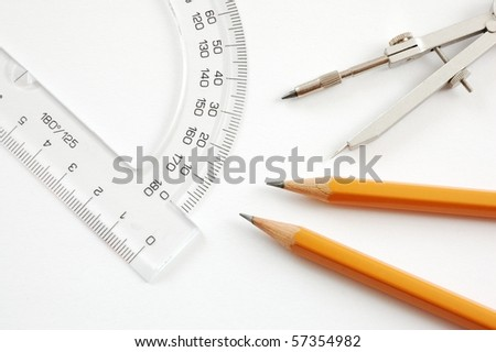 Drawing material - pencils,trammel,protractor on white background - stock photo