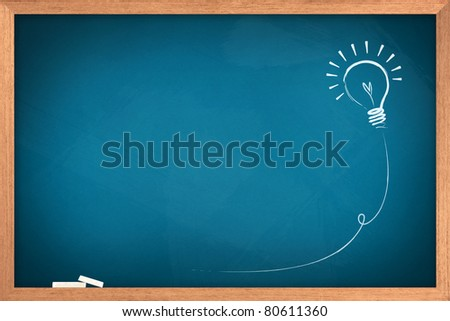 Drawing of a bulb idea on blue board
