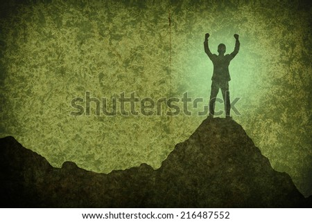 drawing of businessman hold up hands on the peak of mountain on grunge concrete wall and color apply,success concept - stock photo