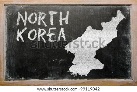 drawing of north korea on blackboard, drawn by chalk - stock photo