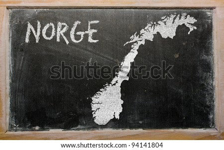 drawing of norway on chalkboard, drawn by chalk - stock photo