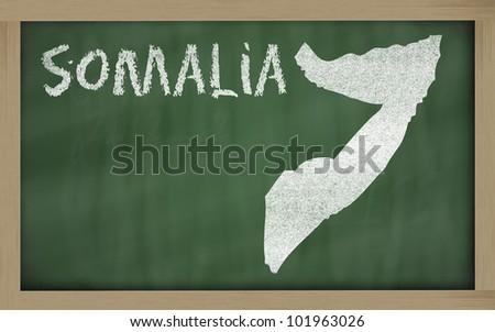 drawing of somalia on blackboard, drawn by chalk - stock photo