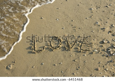 Drawing on sand about love