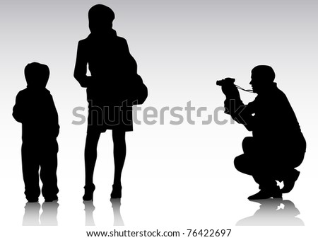 drawing parents and child with a camera - stock photo