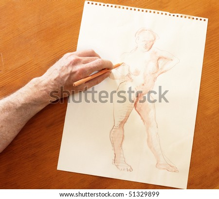 Drawing the human figure with a pencil - stock photo