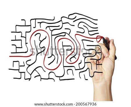 drawing the way out through a maze. - stock photo