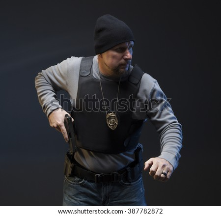Drawing weapon; Undercover Law Enforcement Special Agent ready to fight. - stock photo