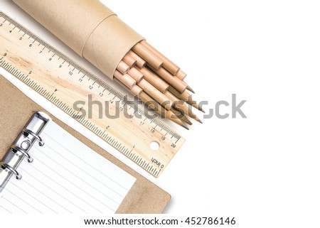Drawings and business tools with leather organiser isolated on white background - stock photo