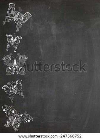 Drawings of various butterflies on chalk board - stock photo