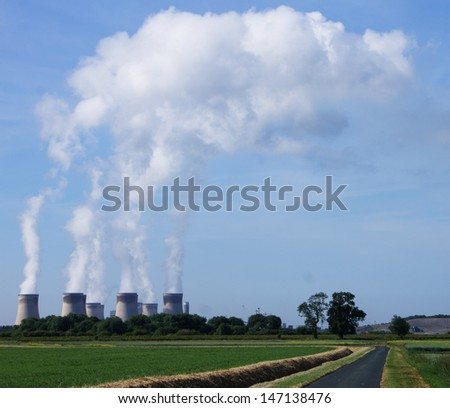 Drax Power Station showing clouds of steam from the cooling towers - stock photo