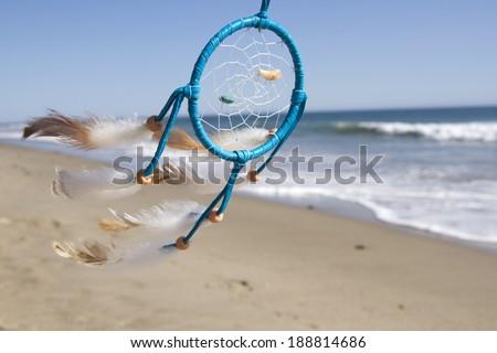 Dream catcher blown around by a light sea breeze - stock photo