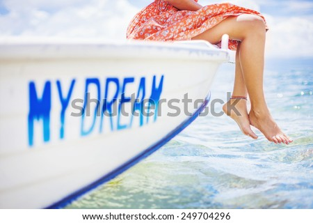 dream concept: woman sailing on a beautiful boat - stock photo