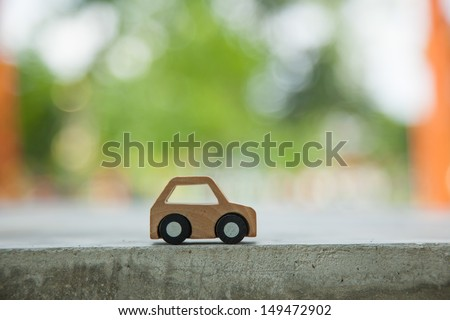 Dream concept. Wooden car model. - stock photo