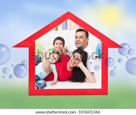 Dream home concept with family inside house sign on abstract sunny field - stock photo
