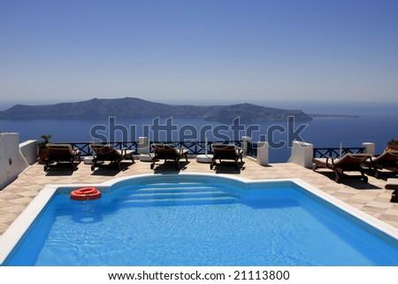 Dream house set on a hill overlooking the sea (Santorini/Greece). - stock photo