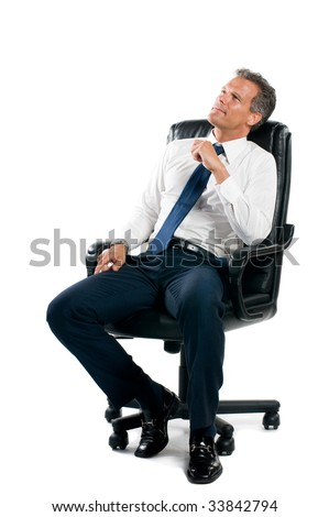 Dreamful pensive businessman sit on his business chair isolated on white background - stock photo