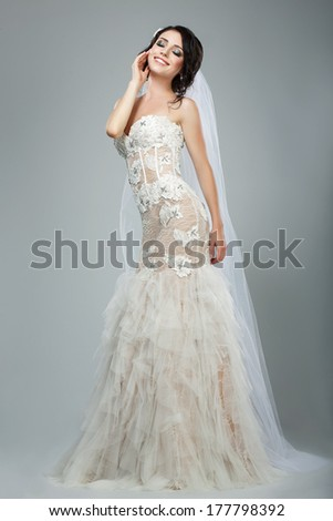 Dreaminess. Full Length of Happy Bride with Closed Eyes in Sleeveless White Dress - stock photo