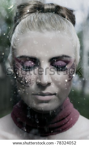 Dreaming Art Image Of A Doll With Creative Makeup Sleeping In A Dream Of Magical Rain While Water Drops Fall Down, Depicting Creativity Imagination And Dreams - stock photo
