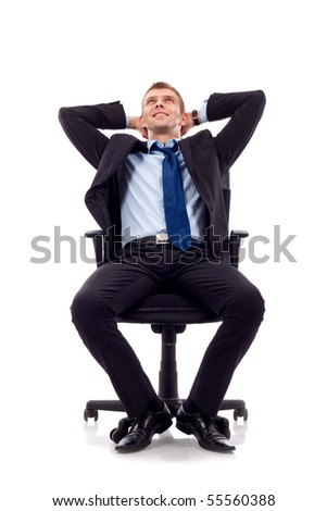 dreaming businessman sits on office chair over white background - stock photo