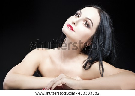 Dreaming Caucasian Brunette Woman With Naked Torso Posing Against Black Background. Horizontal Image Composition