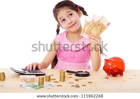 Dreaming girl at the table counts money, isolated on white