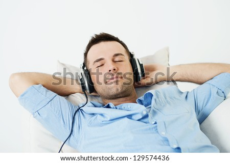 Dreaming man listening to music - stock photo