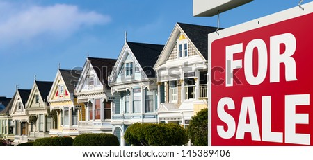 Dreaming of buying one of those colorful iconic San Francisco row houses. For Sale sign is visible in front.