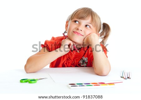 Dreaming schoolgirl with red pencil isolated - stock photo