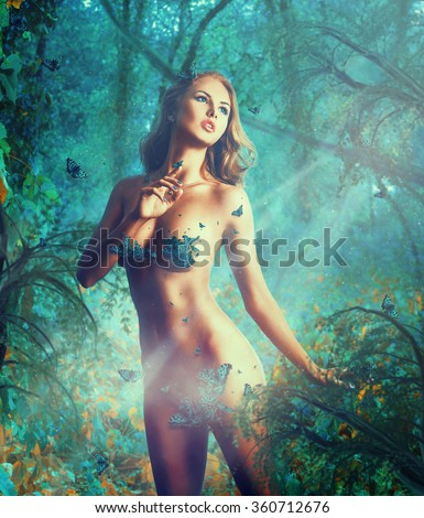 Dreaming sexual slim woman with big natural breast and butterflies in studio - stock photo