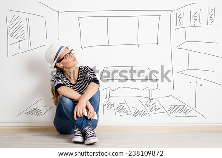 Dreaming woman in headset over drawn living room background. Young pretty female thinking of furnishing her new apartment. - stock photo