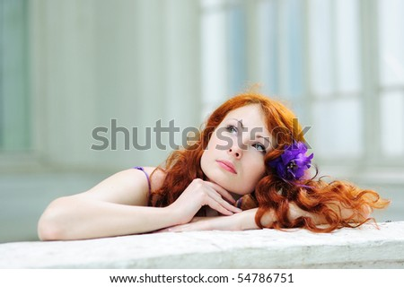 Dreaming woman with a flower in her hairs - stock photo