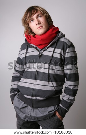 Dreaming young man in casual outfit. - stock photo