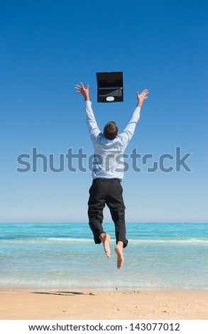 Dreams come true. First day of vacation.Businessman  on the beach - stock photo
