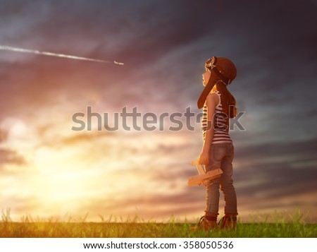 dreams of flight! child playing with toy airplane against the sky at sunset - stock photo