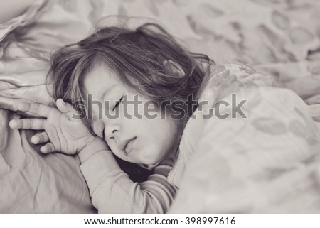 dreams of the toddler sweet girl at home - stock photo