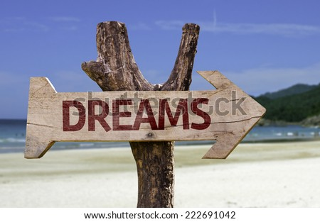 Dreams wooden sign with a beach on background - stock photo