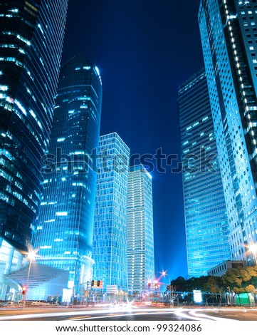 Dreamy blue of modern office buildings at night in Shanghai Far East - stock photo