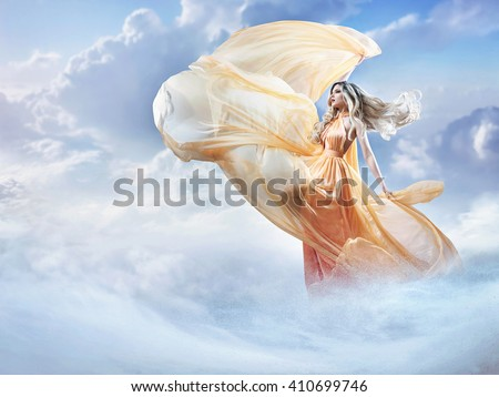 Dreamy image of a beautiful young lady in the clouds