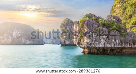 Dreamy rocks  in lagoons of Halong Bay on sunset, Vietnam