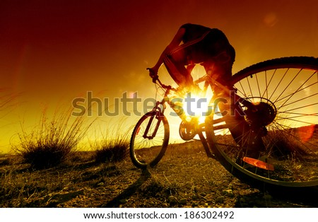 Dreamy sunset and healthy life.Fields and bicycle - stock photo