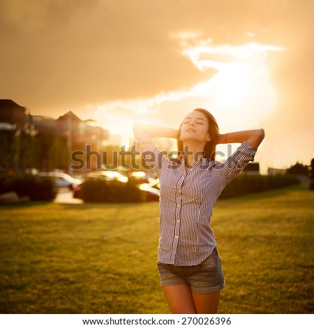 Dreamy Woman Enjoying Life. City Sunset. Relaxation Concept. Toned and Filtered Photo. Copy Space. - stock photo