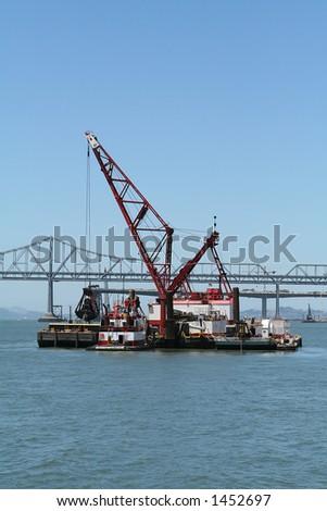 Dredge at the Harbor - stock photo