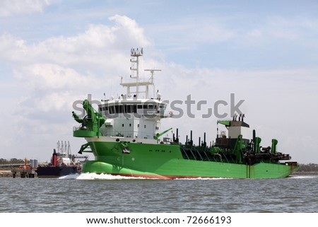 Dredger, industrial ship that digs sand - stock photo