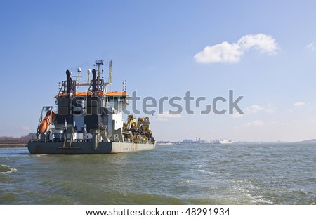 Dredger Oranje fully loaded back - stock photo