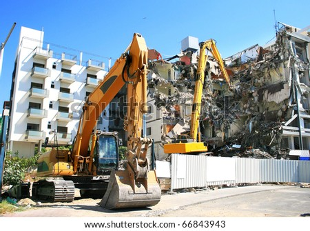 Dredges  and destroyed building. - stock photo
