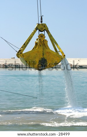 Dredging a harbour. - stock photo