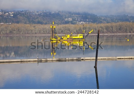 Dredging boats in the Columbia River Oregon. - stock photo