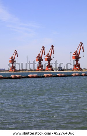 Dredging buoy and gantry crane in the dock