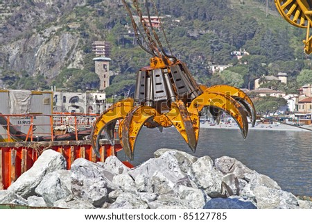 Dredging claw at their hard work - stock photo